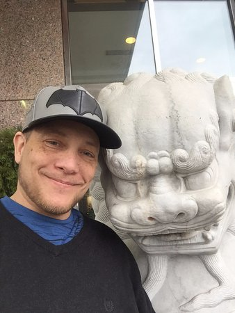 Adam's Mark Buffalo: I loved the foo dog statues out front and took a photo with one :)