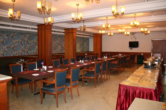 Hotel Komfort Suites: Multicuisine restaurant