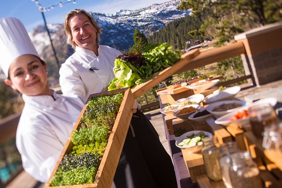 Resort at Squaw Creek: Our Executive Chef and culinary team member hold greens from the resort's on-site garden