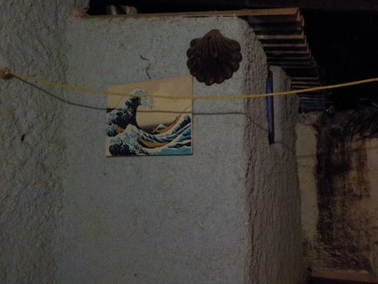 Anjuna, India: painting on the common wall of bathroom and pool