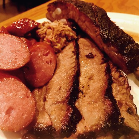 Dink's Pit Bar-B-Que: Dinks 4 meat plate is a great way to go to get a sample of some good BBQ.
