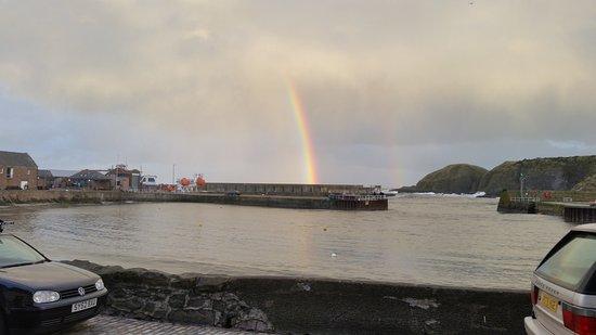 Stonehaven, UK: Rainbow over breakwater