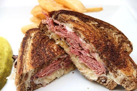 Sebring, فلوريدا: The Reuben Panini-1/4 Lb Corned Beef, Swiss Cheese, Saurkraut, Thousand Island Dressing, Rye Bre