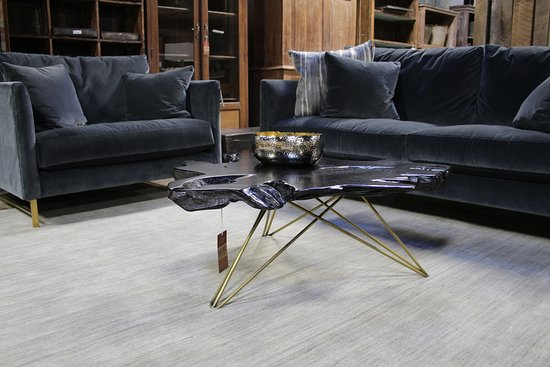 Dwellings: This gorgeous sofa and chair and a half come standard on a brushed brass base. Shown in velvet.