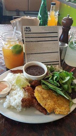 San Rafael, CA: Camarones empanizados (plantain-fried prawns) with black beanns, rice, salad and plantains.