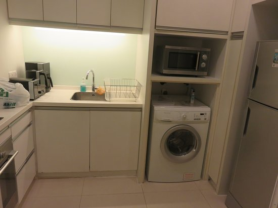 Fraser Place Kuala Lumpur: well equipped kitchen with washer/dryer