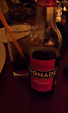 Cafe BilderBuch: An organic lemonade with elderberry flavor, called Bionade, which is quite popular in Germany an
