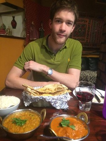 Olive Green Kitchen: My partner smiling. This was our main course with rice, naan bread and a glass of wine each.