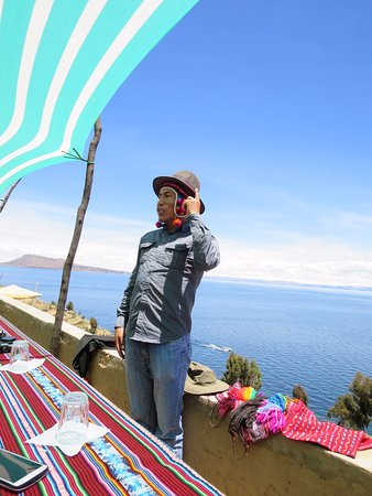 All Ways Travel: Our guide modelling the double hat worn by the village president on Taquile Island.