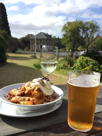 The Pear Tree: House Beer & Wine with a side of wedges, overlooking the Stone Store.