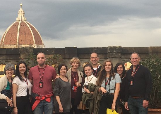 Florence Custom Tours: Our family on terrace of Uffizi, gathered around our wonderful guide Adri.