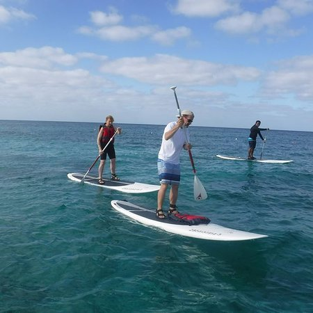 Ha Haak Paddleboarding Cozumel : Here we are, paddleboarding! Juan in the background.