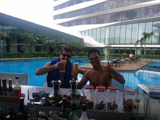 Conrad Manila: Fun time by the pool with my guide and driver, and a great friend.