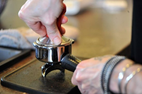 Dover Foxcroft, ME : Lori tamping her freshly ground espresso beans