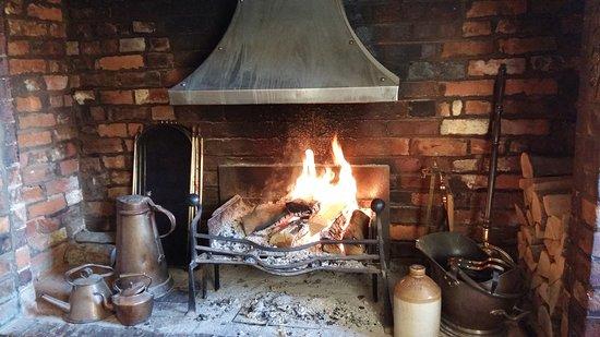 Kempsey, UK: Ingleknook log burning fireplace - lovely when cold outside