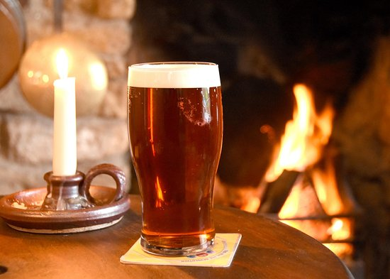 Burythorpe, UK: Pint by the fire