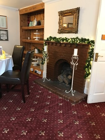 Willingdon, UK: Fireplace in dining room
