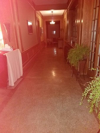 Clifford, PA: Hallway to closed restaurant and sitting room with leaking gas fireplace