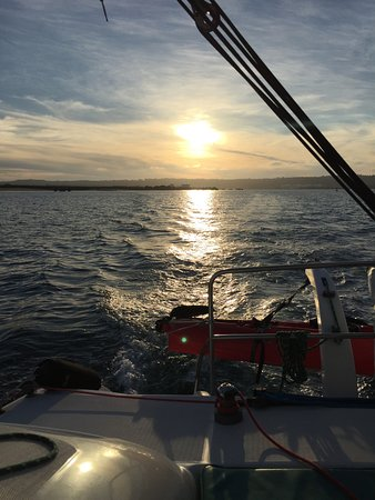 Fun Cat Sailing Catamaran Adventures: Sun setting while sailing with FunCat Sailing 12-12-2016