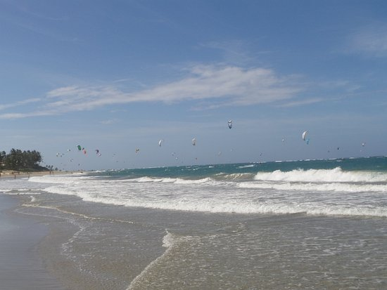 The main beach in Cabarete,  a beautiful day, so many kite surfers, another day in paradise