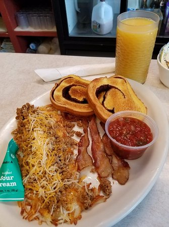 Birchwood, WI: Now that's a breakfast.  Spanish Hash Browns, Bacon, Cinnamon Toast and a tall glass of Orange J