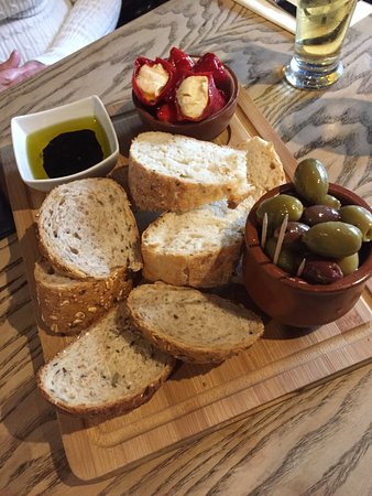The Gribble Inn: Appetisers - Artisan breads, marinated harlequin olives and mini red peppers stuffed with feta
