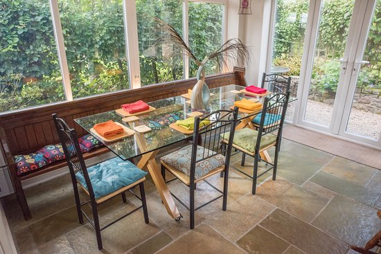 Llangorse, UK: Our pretty light and airy garden dining room can seat up to 10 people if large group booking