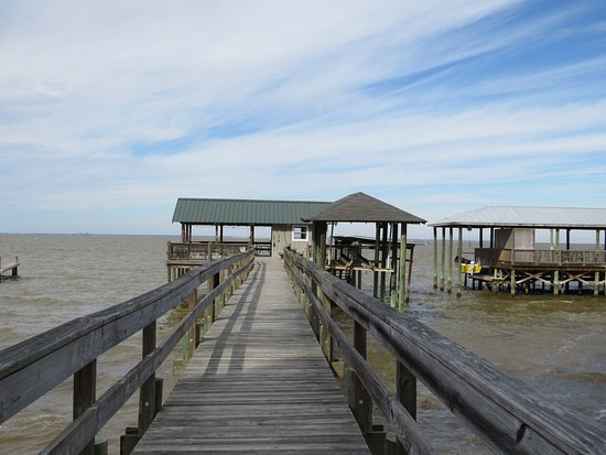 Point Clear Cottages: The pier. There are chairs and a hammock to use.