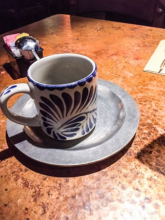Silverdale, WA: Coffee cup on distressed metal table top.