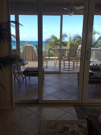 Beachcomber Grand Cayman: View from the living room of the screened in porch and patio