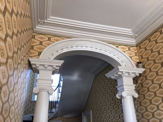 """Davenport House Museum: Archway and molding in the hallway of the """"first floor"""" of Davenport House."""