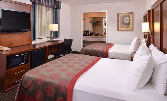Guest Room  with Two Queen Beds offers Free Wifi, microwave, Flat Screen 66 channels, refrigerat