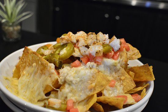 Carrollton, VA: Seafood Nachos - A MUST have!!! - Shrimp, crab, she crab, mozzarella, tomato, hot sauce, Old Bay