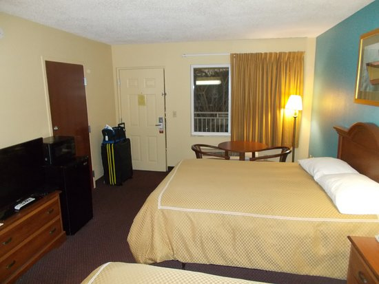Super 8 by Wyndham Dania/Fort Lauderdale Arpt: View to door and balcony, and HVAC unit
