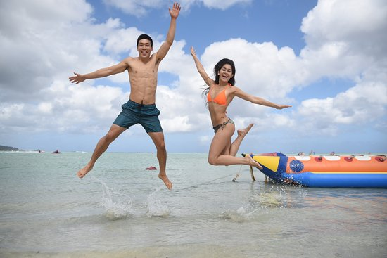 Tamuning, Mariana Islands: Jumping for joy in front of our Unique ABC Banana Boat design.