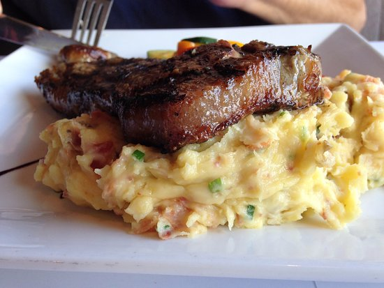 Twisted Fish Steakhouse: Flavorful mashed potatoes that are mixed with onions and bacon.
