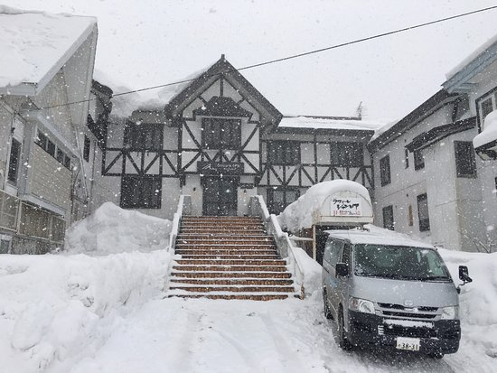 Active Life Madarao: Hotel entrance. The covered entrance to the ski room is at the right-hand side of the stairway.