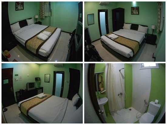 Green Suites Hotel: room 203 and bathroom