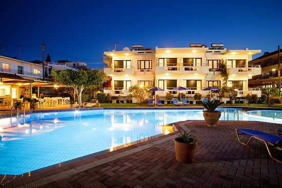 Lefka apartments and pool at night