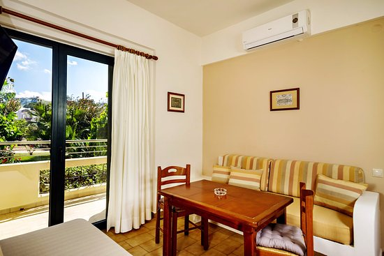 Lefka Apartments One Bedroom Apartment The Dining Room Has A Single Bed 1