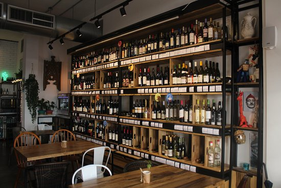 Our kind of library; the wine cabinet! - Picture of Cantina ...