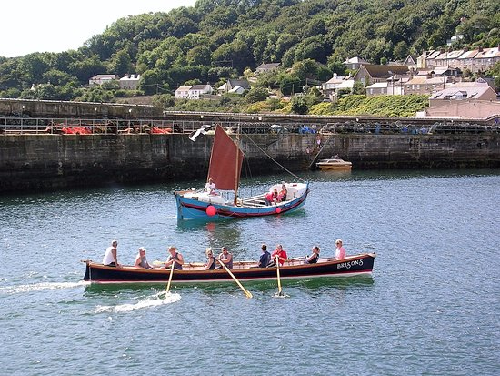 Newlyn, UK: Gig racing and a traditional sail boat in the harbour