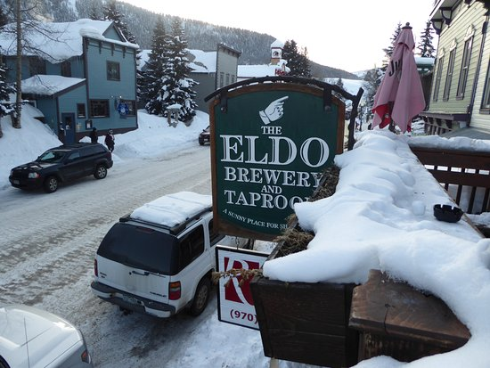 The Eldo Brewery and Happy Trail's Cafe: Snowy sign! Burrr...