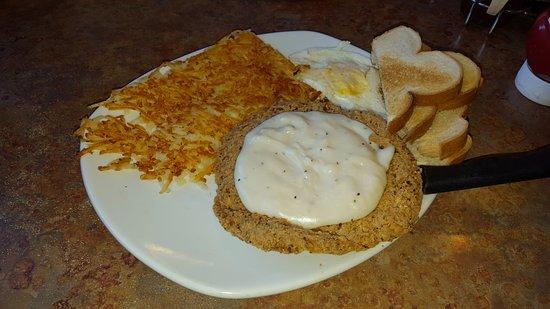 Blaine, MN: Country fried steak, gravy, toast, hashbrowns over easy eggs.