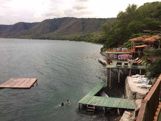 Posada Ecologica la Abuela: A view of the swimming area and sun decks taken from the far end of the resort