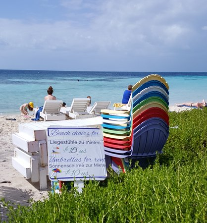 Goff's Caye: Chair and umbrella rentals
