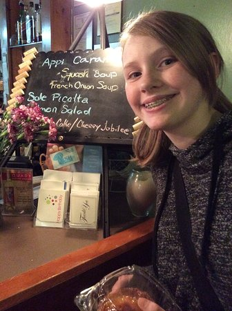 Chez Yasu French Restaurant: My happy granddaughter after her lovely Samon and Creme Broulee.