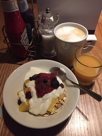 Premier Inn London Euston Hotel: Muesli, no fat yogurt, dried fruit and coulis with costa coffee latte and OJ with a dash of cran