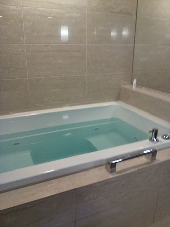 r installing costs factors of average two a and cost bathtub jacuzzi for prices tub