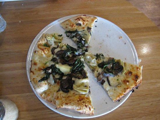 Sauce Pizza & Wine: half of the pizza is gone - thin, mushroom, white sauce, artichoke hearts, smoked cheese